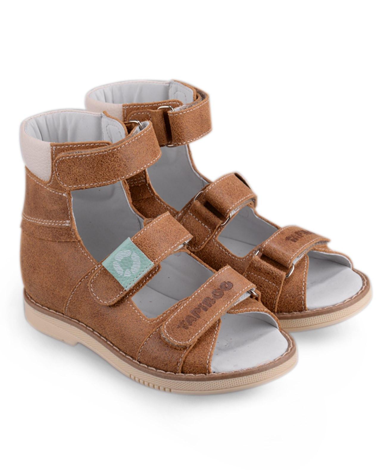 Сандалии Детские, Tapiboo БукСандалии<br>Эти ортопедические сандалии разработаны <br>для коррекции стоп при вальгусной деформации, <br>а также для профилактики плоскостопия. <br>Применение данной модели рекомендовано <br>детям при наличии сформировавшихся деформаций. <br>При применении данной обуви рекомендуется <br>использование индивидуальных ортопедических <br>стелек по назначению врача-ортопеда. Жесткий <br>фиксирующий задник увеличенной высоты <br>и возможность регулировки полноты тремя <br>застежками «велкро» обеспечивают необходимую <br>фиксацию голеностопа в правильном положении. <br>Широкий, устойчивый каблук, специальной <br>конфигурации «каблук Томаса». Каблук продлен <br>с внутренней стороны до середины стопы, <br>предотвращает вращение (заваливание) стопы <br>вовнутрь (пронационный компонент деформации, <br>так называемая косолапость, или вальгусная <br>деформация). Подкладка из кожи теленка без <br>швов. Кожа теленка обладает повышенной <br>износостойкостью в сочетании с мягкостью <br>и отличной способностью пропускать воздух <br>для создания оптимального температурного <br>режима (нога не потеет). Отсутствие швов <br>на подкладк<br>Размер INT: M; Цвет: Красный; Ширина: 100; Высота: 200; Вес: 1000;